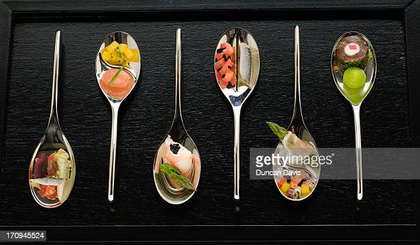 miniature seafood starters on spoons