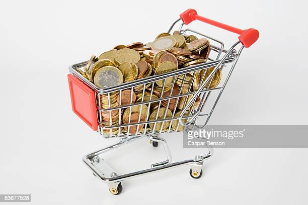 A miniature shopping cart full of European Union coins