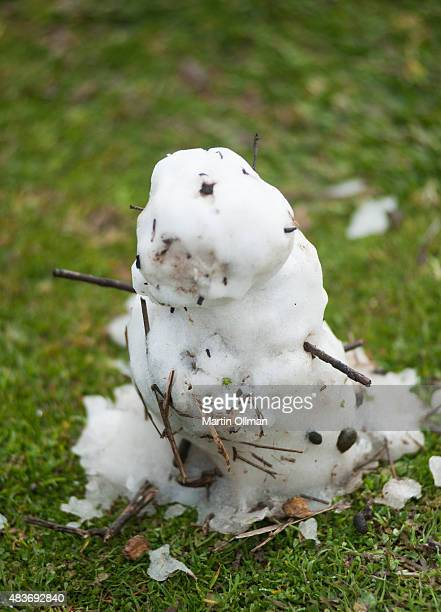 A miniature snowman left on the ground after brief snowfall in the CBD is seen on August 12 2015 in Canberra Australia The snowfall is the first in...