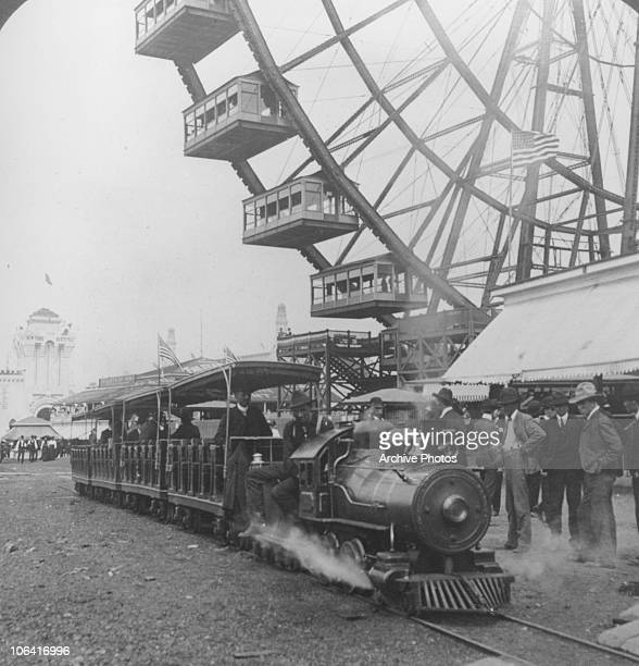 A miniature train carrying passengers around the 1904 World Fair held in St Louis Missouri