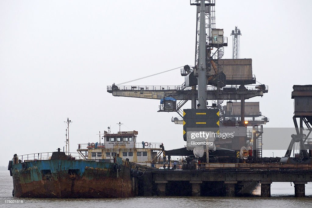 A mini-bulk carrier ship is moored at the JSW Steel Ltd. jetty, operated by JSW Dharamtar Port Pvt. Ltd, near JSW Steel's manufacturing facility in Dolvi, Maharashtra, India, on Friday, July 27, 2013. JSW Steel is scheduled to announce first-quarter earnings on July 31. Photographer: Adeel Halim/Bloomberg via Getty Images