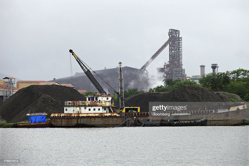 A mini-bulk carrier ship sits moored at a raw material berth at the JSW Steel Ltd. manufacturing facility in Dolvi, Maharashtra, India, on Friday, July 27, 2013. JSW Steel is scheduled to announce first-quarter earnings on July 31. Photographer: Adeel Halim/Bloomberg via Getty Images