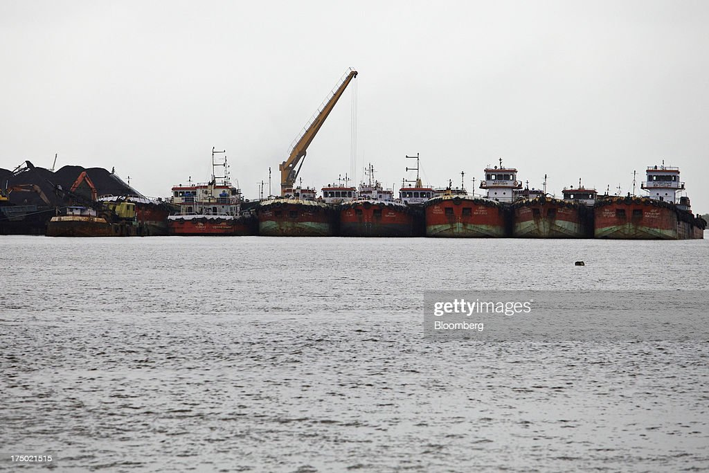 Mini-bulk carrier ships sit moored at the JSW Steel Ltd. manufacturing facility in Dolvi, Maharashtra, India, on Friday, July 27, 2013. JSW Steel is scheduled to announce first-quarter earnings on July 31. Photographer: Adeel Halim/Bloomberg via Getty Images