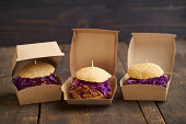 Mini-Burger with pulled pork, red cabbage and fried onions in boxes