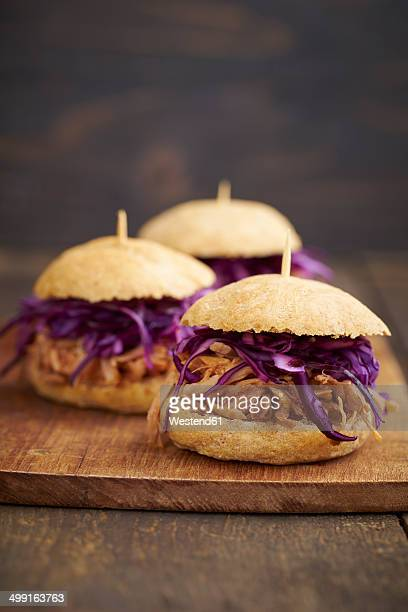 Mini-Burger with pulled pork, red cabbage and fried onions