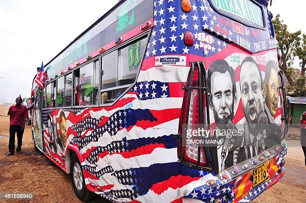 Minibus driver Solomon Murimia calls on clients next to his 'matatu' minibus with a painting depicting US Presidents Abraham Lincoln and Barack Obama...