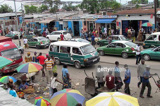 Minibuses wait for passengers on a busy thoroughfare in Brazzaville on October 24 ahead of tomorrow's controversial referendum allowing the longtime...