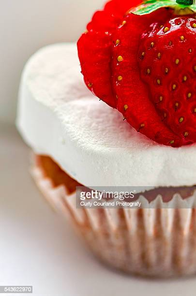 Mini-cupcake with marshmallow and sliced stawberry