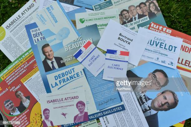 Minielection posters and French voter's card French legislative elections are scheduled to take place on 11 and 18 June to elect the 577 members of...