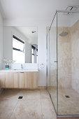 Minimalist beige marble tiled contemporary bathroom in a luxury Australian home