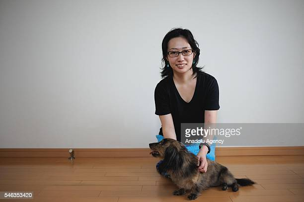 Minimalist Saeko Kubishiki poses for a photograph with her dog in her apartment in Fujisawa Kanagawa Prefecture in the southern of Tokyo Japan on...