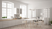 Minimalist scandinavian white kitchen with living room in the background, classic white interior design
