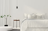 3D illustration. Minimalistic white bedroom with a wooden table