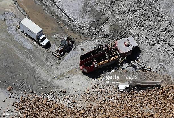 Mining equipment damaged from the Bingham Canyon copper mine wall slide is seen in this aerial photograph taken in Bingham Utah US on Friday April 12...