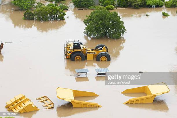 Mining equipment is submerged by flood waters on January 6 2011 in Rockhampton Australia Floodwaters peaked at 92 metres yesterday in the central...