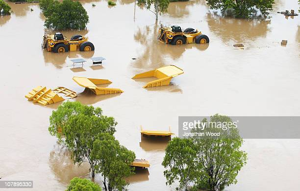 Mining equipment is submerged under flood water on January 6 2011 in Rockhampton Australia Floodwaters peaked at 92 metres yesterday in the central...