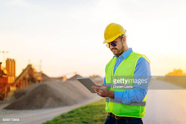 Mining industry and manager near the mine pit