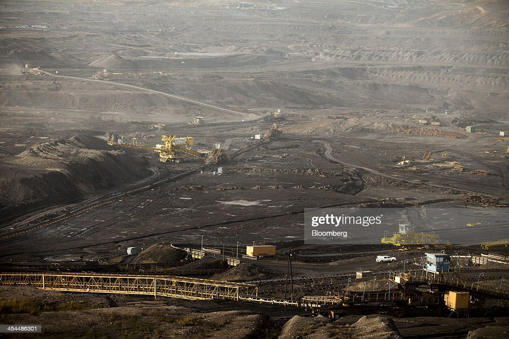 Mining machinery excavates lignite, also known as brown coal, from the floor of the open pit mine operated by Czech Coal AS near the town of Horni Jiretin, Czech Republic, on Friday, Dec. 6, 2013. The government may set up a joint company with Severni Energeticka that will seek lifting current environmental limits on lignite mining, Lidove Noviny reports, citing proposal submitted by Industry and Trade Ministry. Photographer: Bartek Sadowski/Bloomberg via Getty Images