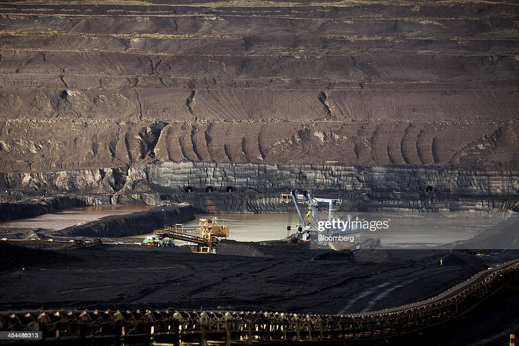 Mining machinery excavates lignite, also known as brown coal, in the open pit mine operated by Czech Coal AS near the town of Horni Jiretin, Czech Republic, on Friday, Dec. 6, 2013. The government may set up a joint company with Severni Energeticka that will seek lifting current environmental limits on lignite mining, Lidove Noviny reports, citing proposal submitted by Industry and Trade Ministry. Photographer: Bartek Sadowski/Bloomberg via Getty Images