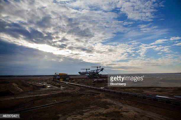 Mining machinery stands at an openpit lignite mine operated by Vattenfall AB in WelzowSued Germany on Saturday Jan 11 2014 Across the continent's...
