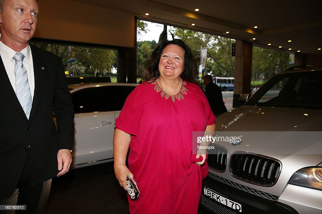 Mining magnate <a gi-track='captionPersonalityLinkClicked' href=/galleries/search?phrase=Gina+Rinehart&family=editorial&specificpeople=6657657 ng-click='$event.stopPropagation()'>Gina Rinehart</a> arrives with her security at the 4th Annual Mining Awards in Sydney, New South Wales.