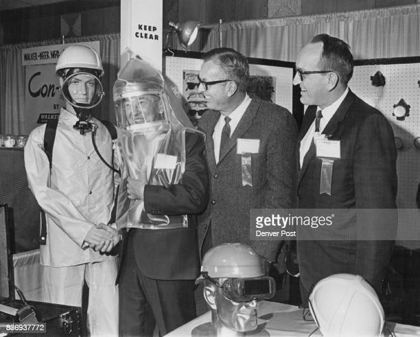 Mining Official Becomes Part Of Exhibit A George Setter of Grand Junction Colo tries on a safety outfit on exhibition at the 71st National Western...