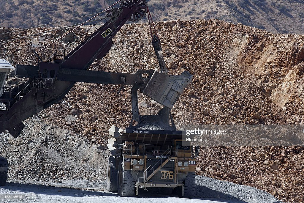 A mining shovel machine loads a Caterpillar Inc. dump truck with copper material at Grupo Mexico SAB's La Caridad open pit copper mine in Sonora, Mexico, on Monday, May 6, 2013. Grupo Mexico SAB, Mexico's biggest mining company by market value, estimates it will produce 840,000 tons of copper in 2013. Photographer: Susana Gonzalez/Bloomberg via Getty Images