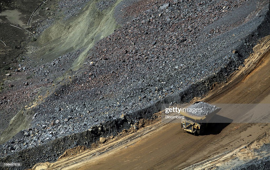 A mining truck carries diamond-bearing kimberlite rock away from the pit floor at the Jwaneng mine, operated by the Debswana Diamond Co., a joint venture between De Beers and Botswana's government, in Jwaneng, Botswana, on Wednesday, Oct. 24, 2012. De Beers, the biggest diamond producer by revenue, is moving the sorting and trading of rough stones to Botswana from London to secure access to the world's largest supplier of diamonds by value and challenge Antwerp's dominance as the world's biggest trading hub for rough diamonds. Photographer: Chris Ratcliffe/Bloomberg via Getty Images