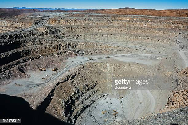 Mining trucks carry diamond bearing rock ore also known as kimberlite from the satellite open pit at the Letseng diamond mine operated by Gem...
