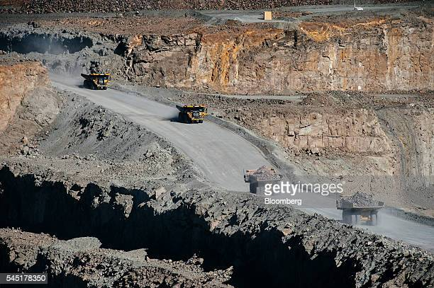 Mining trucks carry diamond bearing rock ore also known as kimberlite from the open pit at the Letseng diamond mine operated by Gem Diamonds Ltd in...