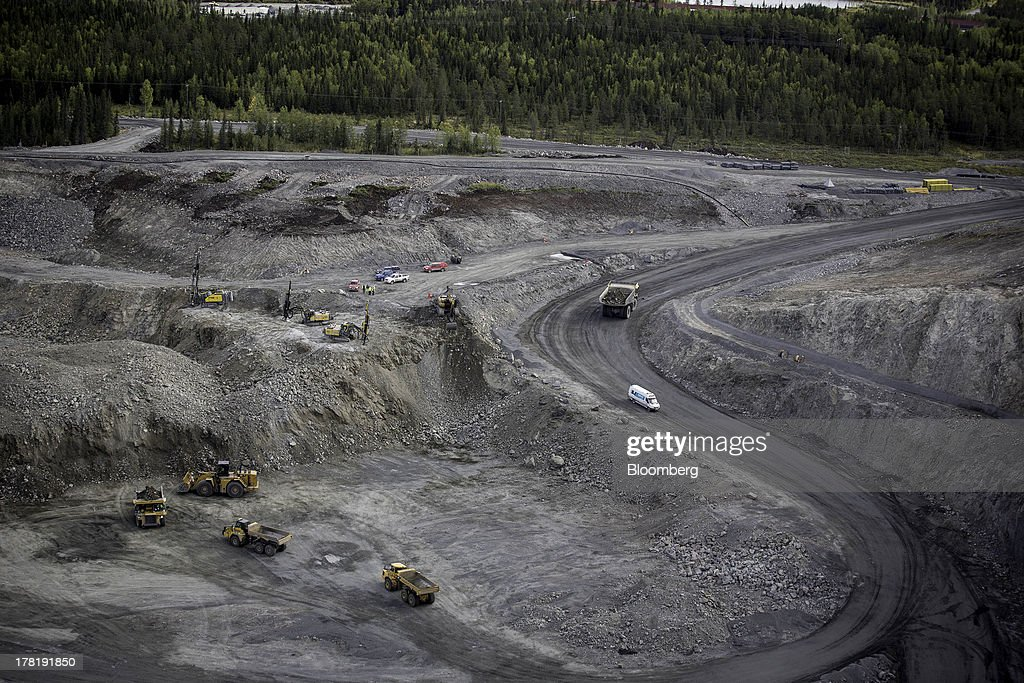 Mining vehicles operate in the pit of the open cast iron ore mine run by LKAB, Sweden's state-owned mining company, in Svappavaara near Kiruna, Sweden, on Thursday, Aug. 22, 2013. Swedes living in the Arctic town of Kiruna are packing up their belongings before their homes are bulldozed to make way for iron ore mining driven by Chinese demand. Photographer: Casper Hedberg/Bloomberg via Getty Images