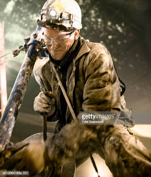 Mining worker working in marble quarry