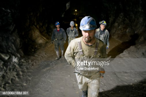 Mining workers walking in marble quarry : Stock Photo