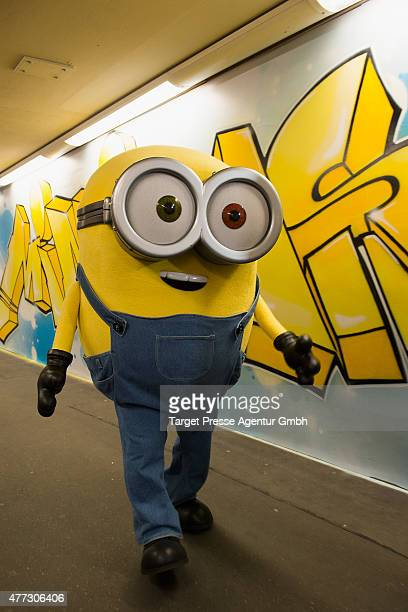 Minion walks down the especially decorated underground station Mehringdamm during a photocall for the film 'Minions' on June 16 2015 in Berlin Germany