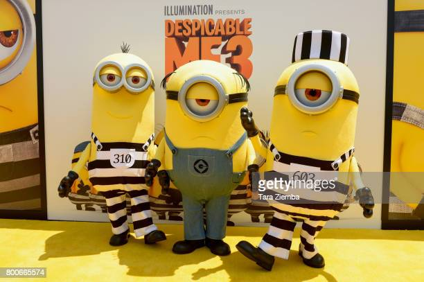 Minions pose for a photo on the yellow carpet at the Premiere Of Universal Pictures And Illumination Entertainment's 'Despicable Me 3' at The Shrine...