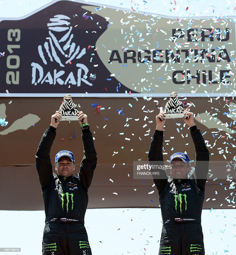 Mini's driver Leonid Novitskiy (R) of Russia and co-driver Konstantion Zhiltsov pose on the podium with their trophies of the Dakar 2013 in Santiago, Chile on January 20, 2013. Mini's driver Stephane Perterhansel (R) of France and co-driver Jean Paul Cottret won the Dakar 2013 ahead of Toyota's driver Giniel De Villiers of South Africa and co-driver Dirk Von Zitzewitz and Mini's driver Leonid Novitskiy of Russia and co-driver Konstantion Zhiltsov.