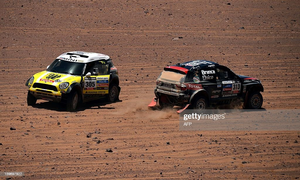 Mini's driver Nani Joan Roma (L) of Spain and BMW's driver Orlanda Terranova of Argentina compete in the Stage 13 of the 2013 Dakar Rally between Copiapo and La Serena, in Chile, on January 18, 2013. The rally is taking place in Peru, Argentina and Chile from January 5 to 20.