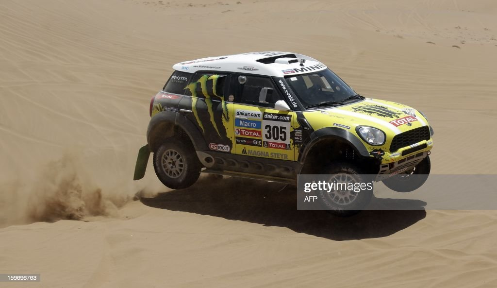 Mini's driver Nani Joan Roma of Spain and co-driver Michel Perin of France compete during the Stage 13 of the 2013 Dakar Rally between Copiapo and La Serena, in Chile, on January 18, 2013. The rally is taking place in Peru, Argentina and Chile from January 5 to 20.
