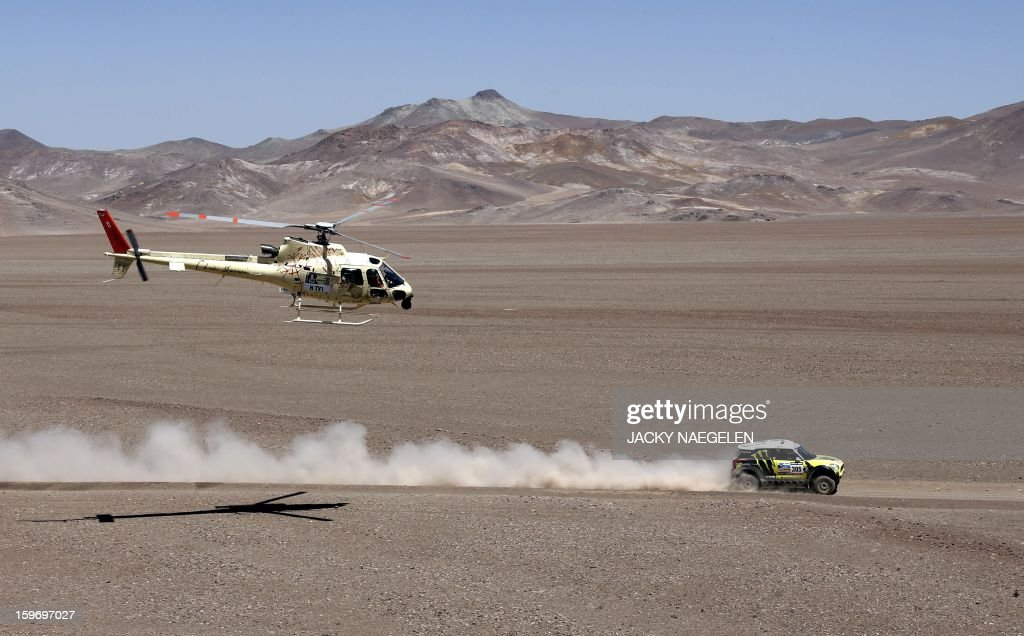 Mini's driver Nani Joan Roma (C) of Spain and co-driver Michel Perin of France compete during the Stage 13 of the 2013 Dakar Rally between Copiapo and La Serena, in Chile, on January 18, 2013. The rally is taking place in Peru, Argentina and Chile from January 5 to 20. AFP PHOTO / JACKY NAEGELEN / POOL