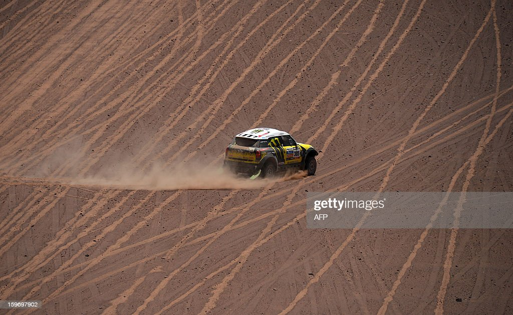 Mini's driver Nani Joan Roma of Spain and co-driver Michel Perin of France compete in the Stage 13 of the 2013 Dakar Rally between Copiapo and La Serena, in Chile, on January 18, 2013. The rally is taking place in Peru, Argentina and Chile from January 5 to 20. AFP PHOTO / POOL