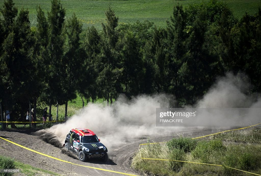 Mini's driver Nani Joan Roma of Spain and co-driver Michel Perin of France compete during the 2015 Dakar Rally stage 1 between Buenos Aires and Villa Carlos Paz, Argentina, on January 4, 2015. AFP PHOTO / FRANCK FIFE