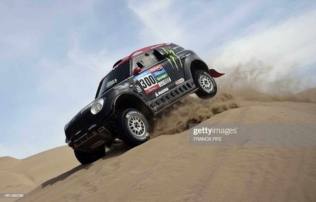 Mini's driver Nani Joan Roma of Spain and co-driver Michel Perin of France jump during the Stage 9 of the Dakar 2015 between Iquique and Calama, Chile, on January 13, 2015. AFP PHOTO / FRANCK FIFE