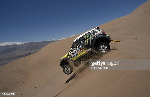 Mini's driver Nani Joan Roma of Spain and codriver Michel Perin of France compete during the Stage 11 of the Dakar 2014 between Antofagasta and El...