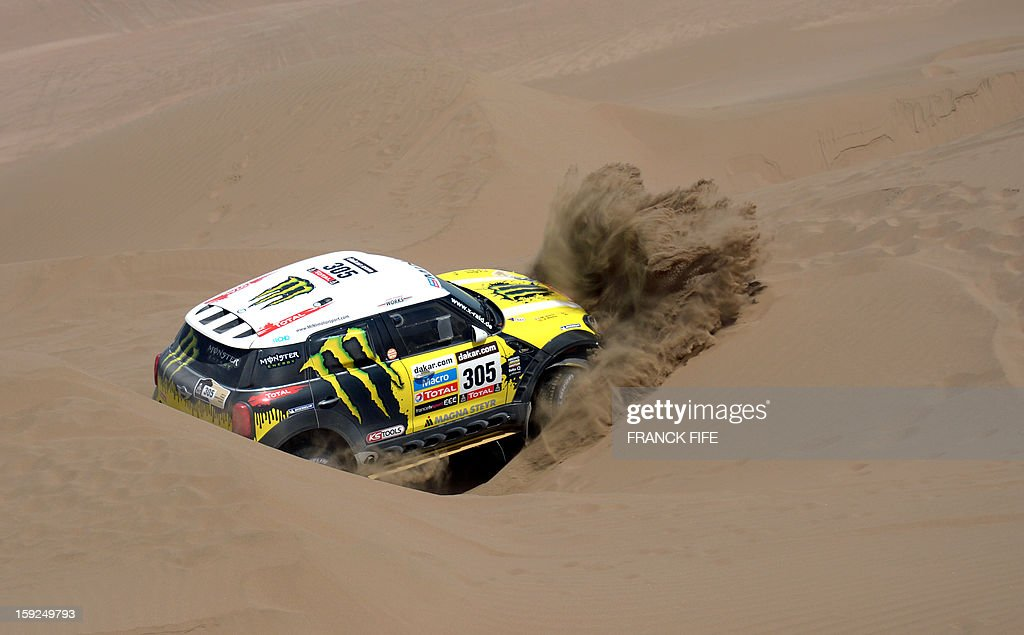 Mini's driver Nani Joan Roma of Spain is stuck in the sand during the Stage 6 of the Dakar 2013 between Arica and Calama, Chile, on January 10, 2013. The rally takes place in Peru, Argentina and Chile from January 5 to 20. AFP PHOTO / FRANCK FIFE