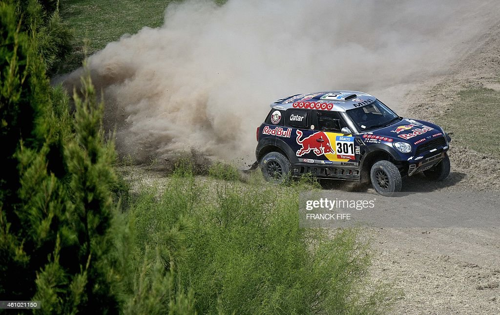 Mini's driver Nasser AlAttiyah of Qatar and codriver Mathieu Baumel of France compete during the 2015 Dakar Rally stage 1 between Buenos Aires and...