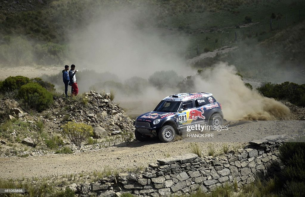 Mini's driver Nasser AlAttiyah of Qatar and codriver Mathieu Baumel of France steers his car during the stage 2 of the Dakar 2015 between Carlos Paz...