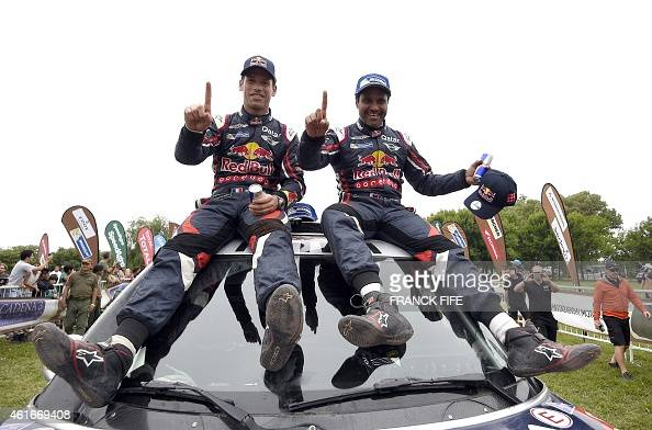 Mini's driver Nasser AlAttiyah of Qatar and codriver Mathieu Baumel of France celebrate their victory at the end of the Stage 13 of the Dakar 2015...