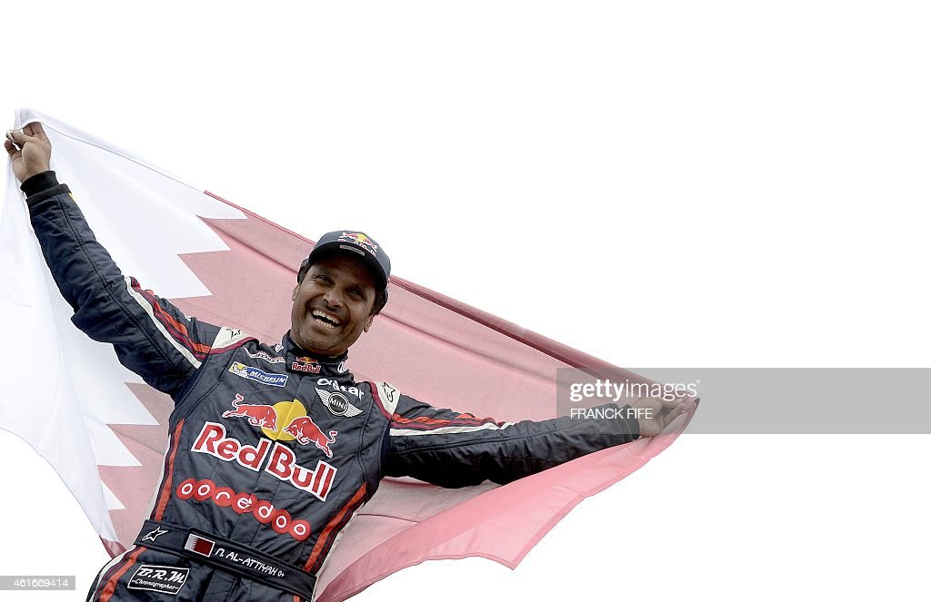 Mini's driver <a gi-track='captionPersonalityLinkClicked' href=/galleries/search?phrase=Nasser+Al-Attiyah&family=editorial&specificpeople=2247125 ng-click='$event.stopPropagation()'>Nasser Al-Attiyah</a> of Qatar celebrates his victory at the end of the Stage 13 of the Dakar 2015 between Rosario and Buenos Aires, Argentina, on January 17, 2015. <a gi-track='captionPersonalityLinkClicked' href=/galleries/search?phrase=Nasser+Al-Attiyah&family=editorial&specificpeople=2247125 ng-click='$event.stopPropagation()'>Nasser Al-Attiyah</a> of Qatar won the Dakar Rally car title for the second time ahead of Giniel De Villiers of South Africa and Krzysztof Holowczyc of Poland.