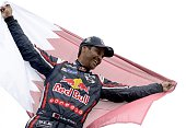 Mini's driver Nasser AlAttiyah of Qatar celebrates his victory at the end of the Stage 13 of the Dakar 2015 between Rosario and Buenos Aires...