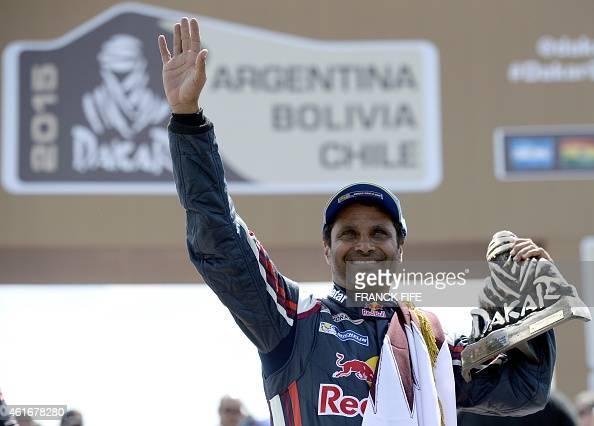 Mini's driver Nasser AlAttiyah of Qatar holds the trophy on the podium of the 2015 Rally Dakar in Buenos Aires Argentina on January 17 2015 AlAttiyah...
